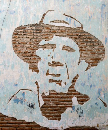 chiseled: Julio Antonio Mella portrait chiseled from brick wall.