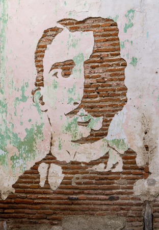 chiseled: Carlos Manuel De Cepedes portrait chiseled from brick wall.