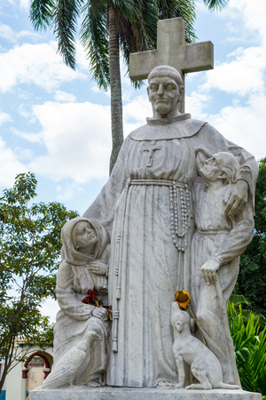 figure out: Father Valencia nursing home at Camaguey. Sculpture of catholic figure out in the garden. Currently, the place is a School of Music Editorial