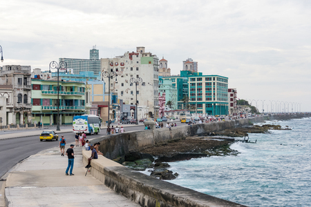 locals: Malecon and Havana city skyline. The landmark is the favorite meeting place for tourists and locals.