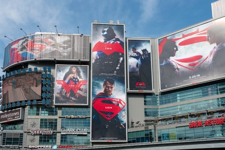 heros: Batman V Superman: Dawn of Justice advertisements in Dundas Square.  The film is a 2016 American superhero film featuring the DC Comics characters Batman and Superman, distributed by Warner Bros. Pictures.