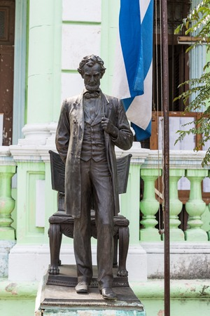 national hero: Cuban English language school with Abraham Lincoln statue or sculpture. The American leader appears by the side of Jose Marti, Cuban National hero