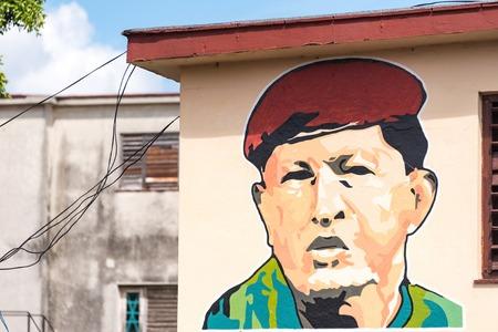 hugo: Hugo Chavez color hand painted portrait on the side of a building