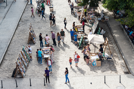 plaza de armas: Old Havana Plaza de Armas or Book Market aerial view: Tourists buying painting and books at antiquities stand Editorial