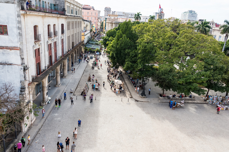 plaza de armas: Old Havana Plaza de Armas or Book Market aerial view: Tourists buying painting and books at antiquities stands