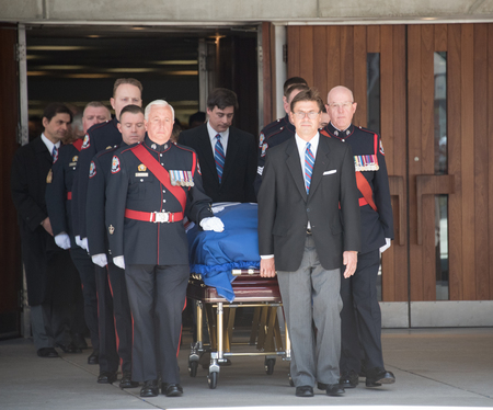 mortician: TORONTO,CANADA-MARCH 30,2016: Rob Ford, former Toronto Mayor, funeral scenes. The procession walked from the City Hall to the St. James Cathedral where the final good bye ceremony was held.
