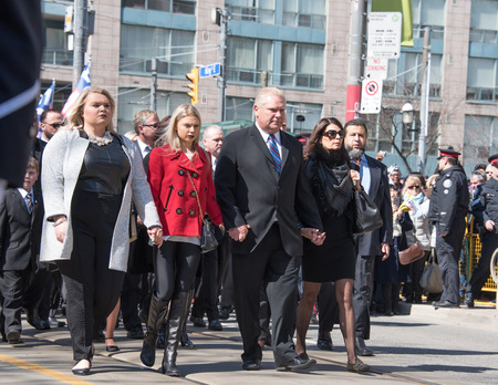 coffin bearer: TORONTO,CANADA-MARCH 30,2016: Rob Ford, former Toronto Mayor, funeral scenes. The procession walked from the City Hall to the St. James Cathedral where the final good bye ceremony was held.