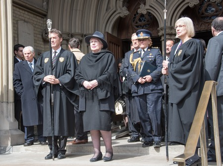 lieutenant: Elizabeth Dowdeswell (lady with fashion hat), Lieutenant Governor of Ontario during Rob Ford, former Toronto Mayor, funeral scenes. The procession walked from the City Hall to the St. James Cathedral where the final good bye ceremony was held. Editorial