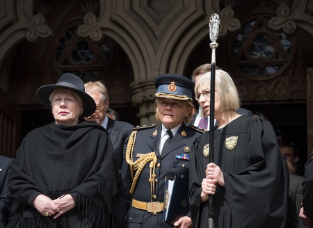 pass away: Elizabeth Dowdeswell (lady with fashion hat), Lieutenant Governor of Ontario during Rob Ford, former Toronto Mayor, funeral scenes. The procession walked from the City Hall to the St. James Cathedral where the final good bye ceremony was held. Editorial