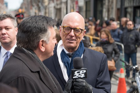 coffin bearer: Stephen LeDrew interviewing Charles Souza during Rob Ford, former Toronto Mayor, funeral scenes. The procession walked from the City Hall to the St. James Cathedral where the final good bye ceremony was held.