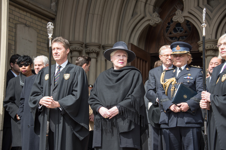 coffin bearer: Elizabeth Dowdeswell (lady with fashion hat), Lieutenant Governor of Ontario during Rob Ford, former Toronto Mayor, funeral scenes. The procession walked from the City Hall to the St. James Cathedral where the final good bye ceremony was held. Editorial
