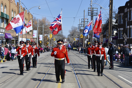 notorious: Different Candian flags in the Lions Club Easter parade which celebrates its 50th anniversary