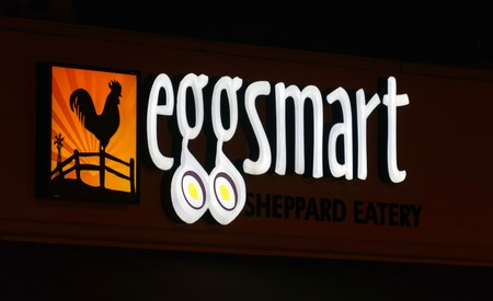 reasonable: Eggsmart sign at night, Egg smart serves lunch and brunch and is known for their large portion sizes for a reasonable price.