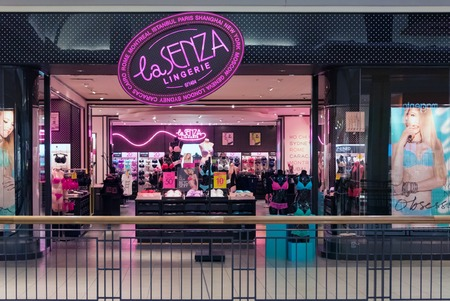 article of clothing: La Senza pink store sign. Store known selling high quality clothing article design for young teenager girls.