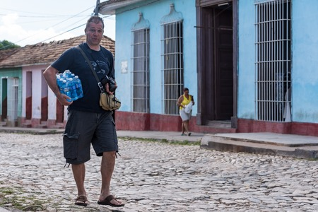 extreme heat: Tourist carrying water bottles. Due to the extreme heat waves Cuba suffers from, drinking water is a necessity to keep dehydration away. Editorial