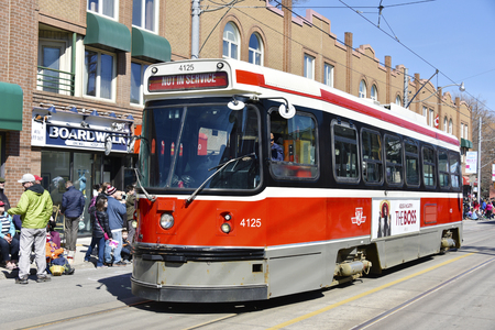 notorious: Toronto 2016 Beaches Lions Club Easter Parade: Vintage TTC streetcars. The parade celebrates 50th anniversary in the Queen Street East during Easter Sunday