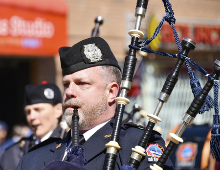 notorious: Police Pipe and Drums Band at Lions Club Easter parade, celebrating 50th anniversary: Scottish marching band playing the Bagpipe