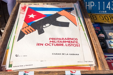 october: Antiquities stand selling military posters that read Military prepared, ready in october