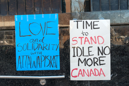 toronto: TORONTO,CANADA-APRIL 17,2016: Idle No More, Black Lives Matter protesters occupy the Toronto office Occupation of Indigenous and Northern Affairs of the demand action on Attawapiskat suicide crisis