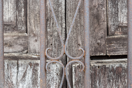 Old Spanish architectural details of vintage house doors with iron guard.  Cuba is know for the wide array of colonial architecture it remains standing on its cities.