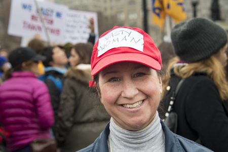 political rally: Toronto,Canada-January 21, 2017: Womens Solidarity March.  Women and their allies marched in support of the Womens March in Washington. Toronto city saw one of the largest events on its history as thousands of people protested the Donald Trump stances.