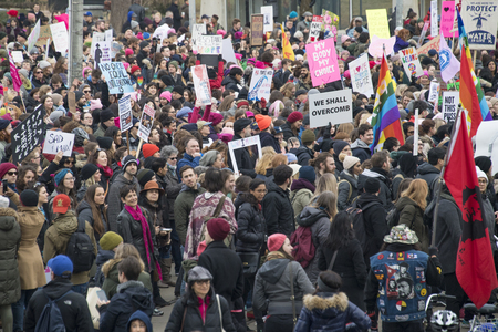 marched: Crowd with signs during Womens Solidarity March, general view.   Women and their allies marched in support of the Womens March in Washington. Toronto city saw one of the largest events on its history as thousands of people protested the Donald Trump sta