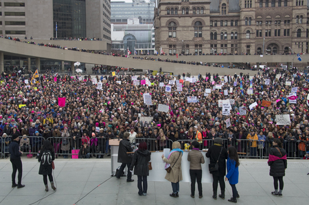 Toronto,Canada-January 21, 2017: Womens Solidarity March.  Women and their allies marched in support of the Womens March in Washington. Toronto city saw one of the largest events on its history as thousands of people protested the Donald Trump stances.