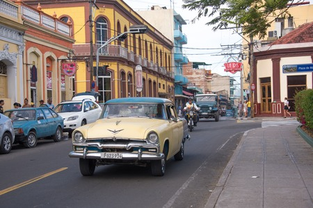 Old Ford 1955. Classic car driving down a busy street in Plaza de Marte.