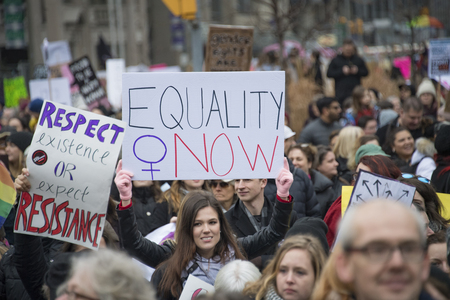 Crowd with signs during Womens Solidarity March, general view.   Women and their allies marched in support of the Womens March in Washington. Toronto city saw one of the largest events on its history as thousands of people protested the Donald Trump sta