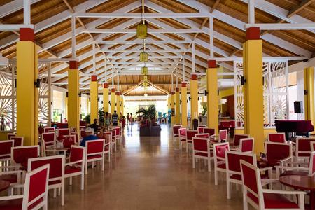 seating area: Cuba tourism: Lobby Hotel Gaviota Cayo Santa Maria . Seating arrangement inside a large resort lobby area.