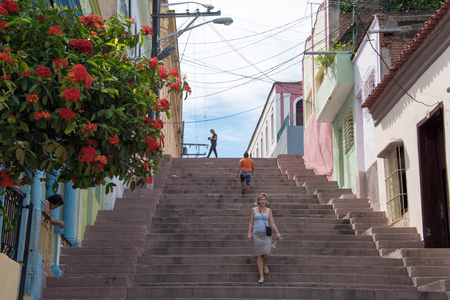 culturally: Pico Steps: the tourist attraction leads to the traditional and culturally rich Tivoli Neighborhood. Tourists walking on city steps, and colorful buildings in background.