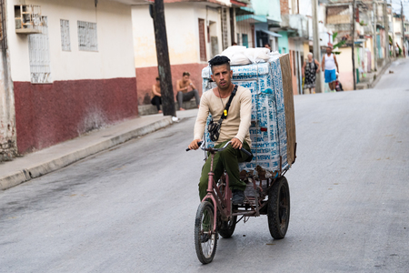 selling service: Cuban real man people selling bread in tricycle. He provides service to remote areas or neighborhoods. Editorial