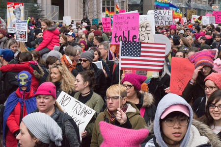 Toronto,Canada-January 21, 2017: Womens March in front of Queens Park building in downtown. Canadian women demand more social justice and protest against Donald Trump policies Redakční