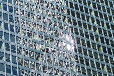 Sunlight reflection in glass facade pattern in  modern high rise building