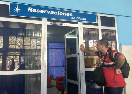 Cuban interprovincial omnibus station: anxious Cuban man waiting to buy a ticket in CUC which is equivalent to USD. Editorial