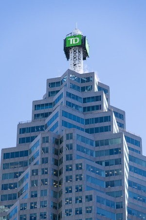 TD Bank building modern architectural detail against a blue sky. Famous highrises in the financial district of Toronto city