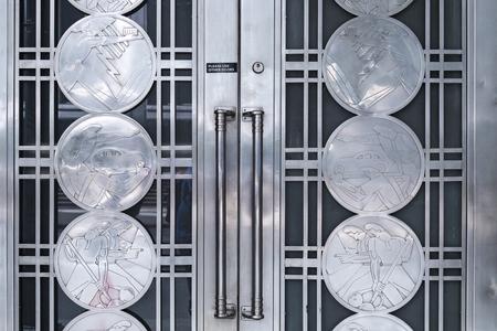 Art in metallic door detail of TD Bank building in downtown. The door is integral part of the old landmark