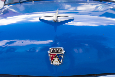 Ford brand name logo in old classic American car still running in Cuban streets. The vehicle is painted blue.
