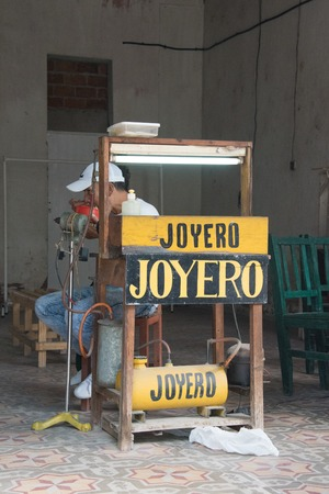 self employed: Cuban self employed  jeweler stand. After economic changes, small private business  are allowed in the Socialist Cuba Editorial