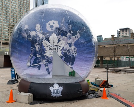 Preparations to celebrate 100 years of the Maple Leafs Hockey Team. Large inflatable ball with picture
