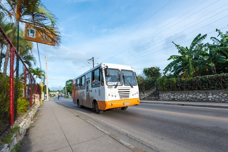 omnibus: Cuban Giron bus omnibus transporting passengers in city or urban area. The Cuban government is making efforts to improve urban public transportation.