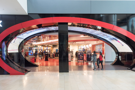 Entrance architecture to modern store in Yorkdale Mall. Stylish arch with digital display on its roof
