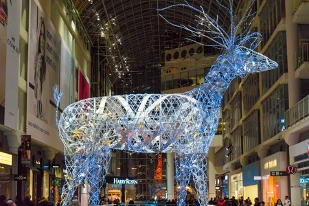 giant lit up metal reindeer standing tall in eaton center part of christmas decoration - Metal Reindeer Christmas Decorations