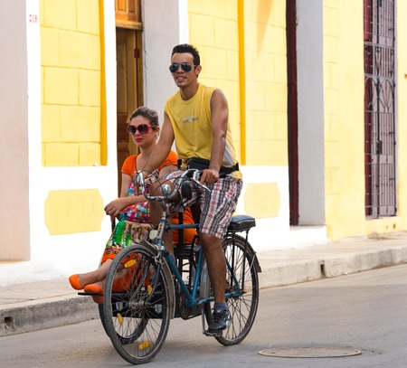 holguin: Transportation in tricycle or bicitaxi. This kind with a sidecar is typical of Holguin city. Cuban real people lifestyle in the Caribbean Island.