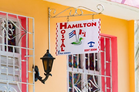 Cuban residing abroad start to invest in small business. Hamilton Hostel ( Spanish: Hostal ) with Cuban and Canadian signs at the main entrance. Editorial