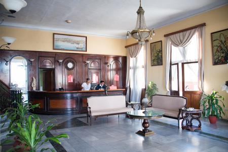 front desk: Hotel Casa Granda lobby. Two attendants at the front desk. The colonial building is a tourist attraction in the city