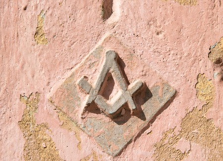 Masonic Square and Compasses symbol in old Cuban buildings. Freemasonry or Masonry consists of fraternal organisations that trace their origins to the local fraternities of stonemasons of the fourteenth century