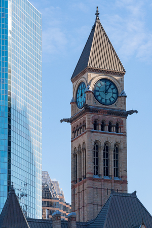 Clock tower of the Old City Hall building. The Richardsonian Romanesque Revival architecture building in a heritage of the Canadian City.
