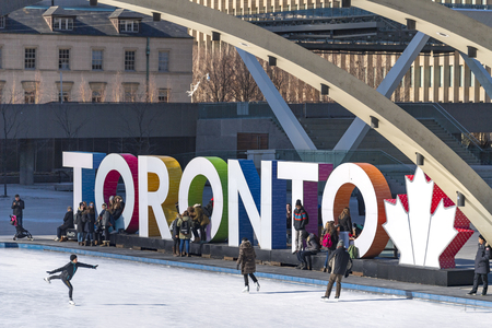Iconic Toronto 3D sign in Nathan Phillips Square and the multicultural city everyday lifestyle in Winter season. The square and the sign are tourists attractions in the Canadian city. Redakční
