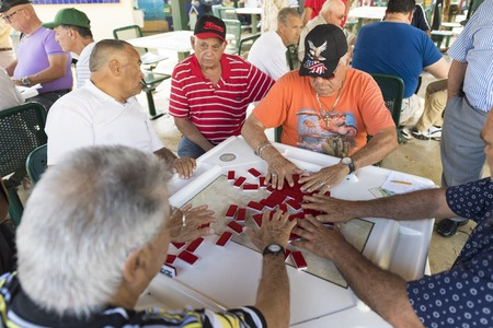 maximo: The Cuban people of Miami playing dominoes in Little Havana. The Maximo Gomez Park a.k.a. Domino Park is a famous place whhich is a major tourist attraction in the city. Editorial